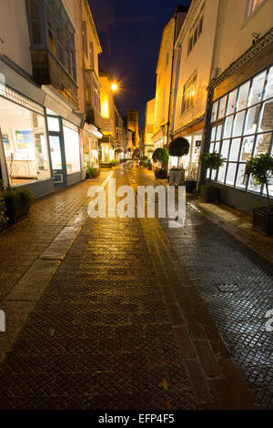 Town of Dartmouth, England. Picturesque night view of art and retails shops in Dartmouth's Foss Street. - Stock Photo