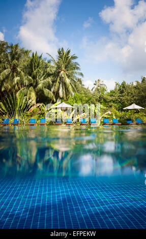 Tropical swimming pool views over the water and under water. Maldives. - Stock Photo