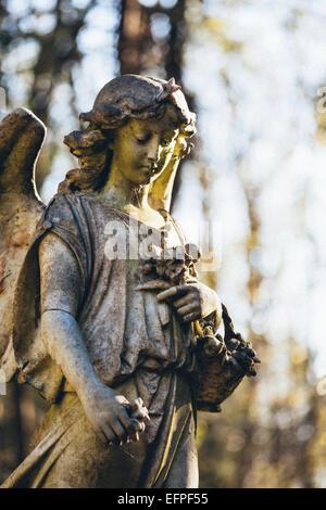 Statue of woman angel, Highgate Cemetery west, London, England, United Kingdom, Europe - Stock Photo