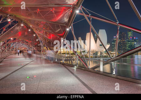 Double Helix Bridge and Art and Science Museum and downtown central financial district at night, Singapore, Southeast - Stock Photo