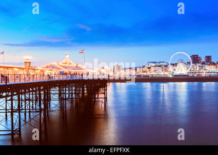 The Palace Pier (Brighton Pier) at dusk, Brighton, East Sussex, England, United Kingdom, Europe - Stock Photo