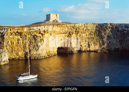 Cliff top watch tower, Comino island, Malta, Mediterranean, Europe - Stock Photo