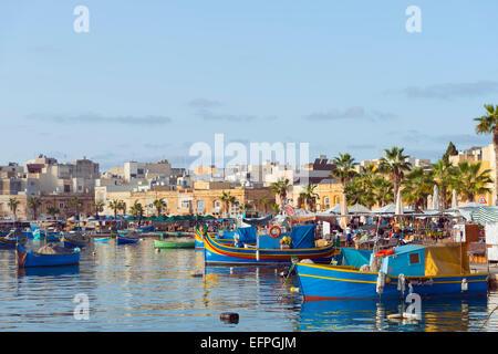 Colourful fishing boats (dghajsa), Marsaxlokk Harbour, Malta, Mediterranean, Europe - Stock Photo
