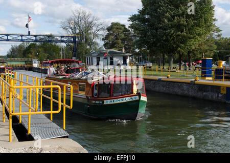 Erie Canal Packet boats leave lock heading west toward Buffalo New York - Stock Photo