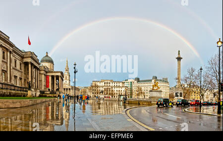 London, United Kingdom - April 12, 2013: rainbow over Trafalgar Square in London. The capital of UK is one of the - Stock Photo
