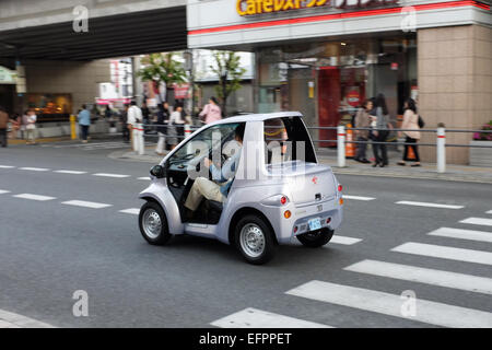 A very small car — the super-compact Toyota COMS electric vehicle (EV). - Stock Photo