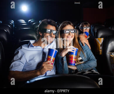 Happy Couple Watching 3D Movie In Theater - Stock Photo