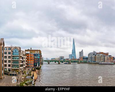 London, United Kingdom - April 13, 2013: London urban view from millennium bridge. The Shard is the newest skyscraper - Stock Photo