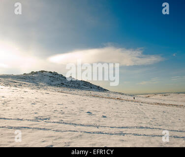 Hill walker near  Brown Willy in the snow on Bodmin moor, North Cornwall. - Stock Photo