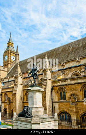Lord Oliver Cromwell statue outside Palace of Westminster, Houses of Parliament, with Big Ben in the background. - Stock Photo