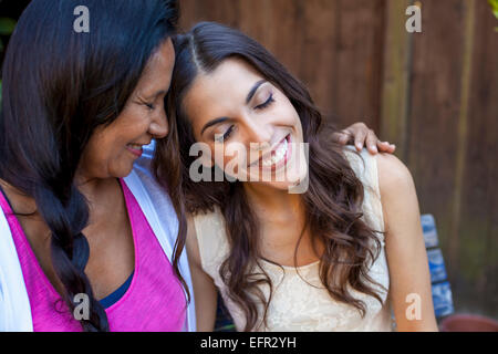 Mother and daughter sharing tender moment - Stock Photo