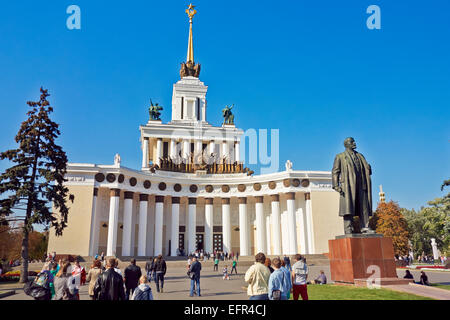People walking in front of the Main Pavillion at the All-Russia Exhibition Centre (VDNKh). Moscow, Russia. - Stock Photo
