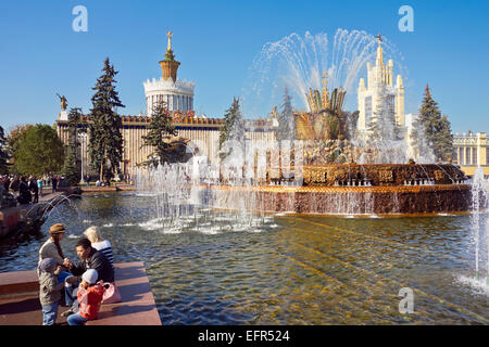 People at The Stone Flower Fountain at the All-Russia Exhibition Centre (VDNKh). Moscow, Russia. - Stock Photo