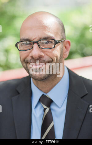 Portrait of mature businessman on street - Stock Photo