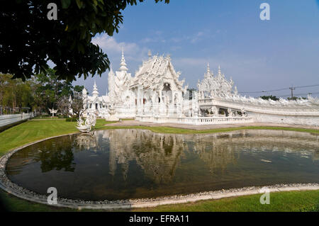 Horizontal view of Wat Rong Khun, the White Temple, in Chiang Rai. - Stock Photo