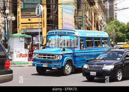 Old blue Dodge D400 bus with other cars on the Plaza del Estudiante (Student's Square) in La Paz, Bolivia - Stock Photo