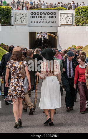 Period costumes at the Goodwood Revival 2014 using the tunnel access under the famous racing circuit. Females in - Stock Photo