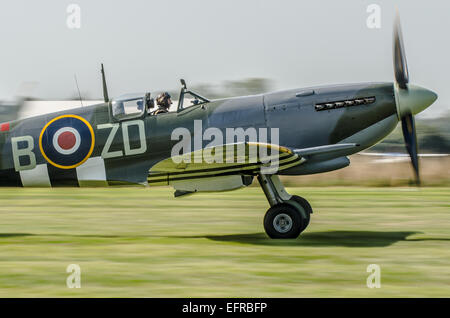 Supermarine Spitfire IX MH434 on its take-off roll at the Goodwood Revival 2014 - Stock Photo