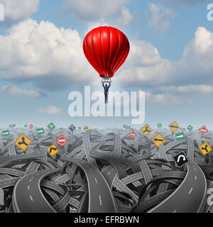 Easy way forward rise above confusion leadership concept with a businessman in a balloon flying and soaring over - Stock Photo