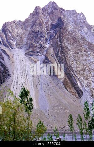 Didar Mubarak written in boulders along the Karakorum Highway - Stock Photo