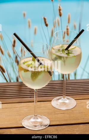 hugo prosecco elderflower soda ice summer drink outdoor aperitif - Stock Photo