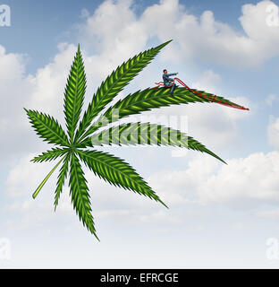Marijuana concept and cannabis leaf flying high with a person guiding the medicinal plant as a symbol for the social - Stock Photo