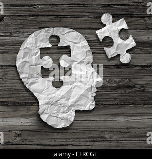 Puzzle head brain concept as a human face profile made from crumpled white paper with a jigsaw piece cut out on - Stock Photo