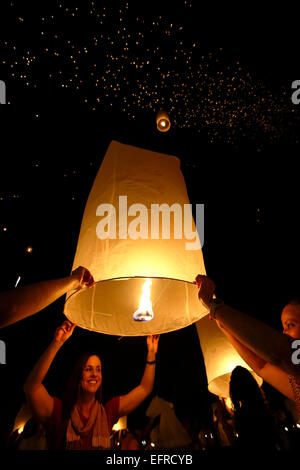 People releasing lanterns, Yeepeng Lanna International Lantern Festival, Lanna Dhutanka, Chiang Mai, Thailand - Stock Photo