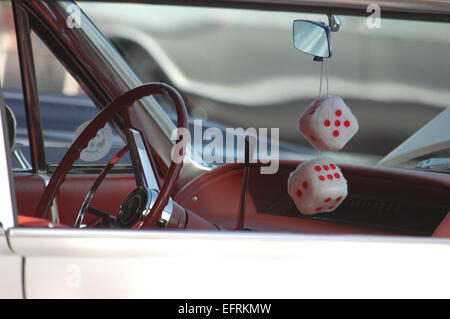 Fuzzy Dice Hanging From Rear View Mirror In 1950 S