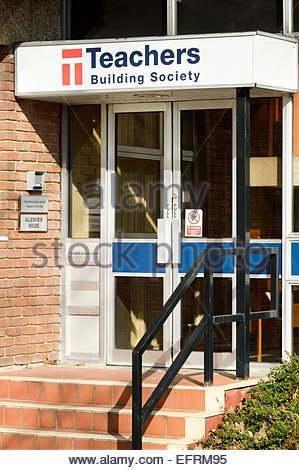 View of the front door and sign above the headquarters of the Teachers Building Society, Wimborne Minster, Dorset. - Stock Photo