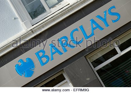 Looking up at the sign above the Fishguard Branch of Barclays Bank - Stock Photo