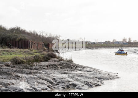 Low tide just passed the marina at Wat Tyler Country Park in Essex - Stock Photo