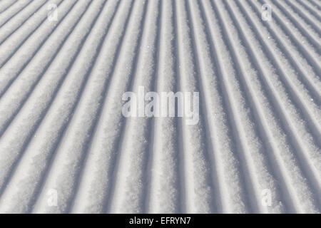 Skiing background - fresh snow on ski slope in the dolomites - Stock Photo