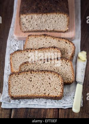 Homemade whole grain rye sourdough bread, sliced. - Stock Photo