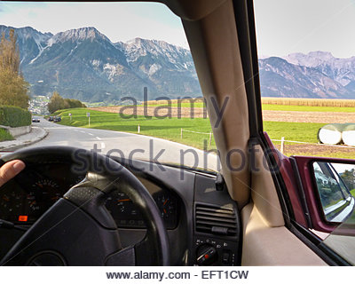 Man Driving Car Driver Steering Wheel Nobody Mountains Alps Countryside Nature Greenery Foliage Austria Europe Innsbruck - Stock Photo