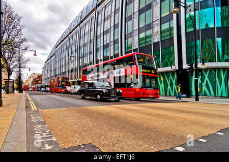 London, UK - April 15, 2013:British icon double decker bus and taxi along Oxford Street in London, UK. Oxford Street - Stock Photo