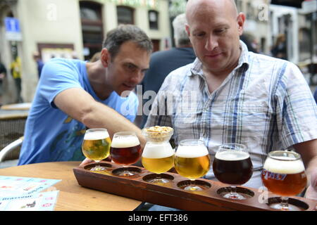 Beer tasting in one of the vibrant bars in the historical center of Brussels - Stock Photo