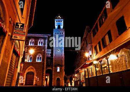 night view of downtown with enlightened Town Hall in Piombino. - Stock Photo