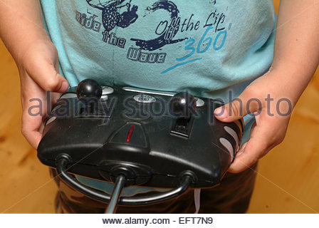 Two Year Old Toddler Boy Child Age 2 Years Portrait Playing Kids Using Remote Control Hand MR Hand Hands - Stock Photo