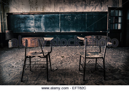 Two chairs in abandoned school class - Stock Photo