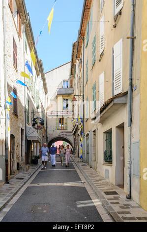 Narrow street in Valbonne, France - Stock Photo