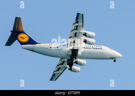 Lufthansa Regional CityLine Avro RJ85 with undercarriage lowered. - Stock Photo