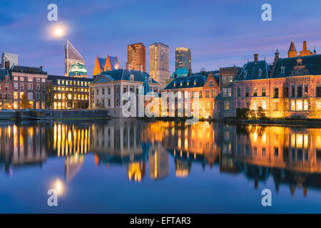 A cityscape of The Hague in the Netherlands with the famous Mauritshuis, the Hofvijver and the Dutch parliament - Stock Photo