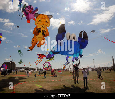 Kites of all shapes and sizes flying over the seafront at Southsea, Hants at the annual Kite Festival. Pic Mike - Stock Photo