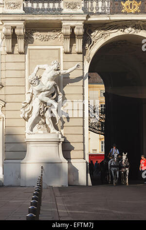 Buggy through the Michaelertor gate at the Hofburg, Vienna's imperial palace. Austria - Stock Photo