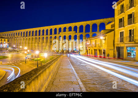 Segovia, Spain old town view at the ancient Roman aqueduct. - Stock Photo