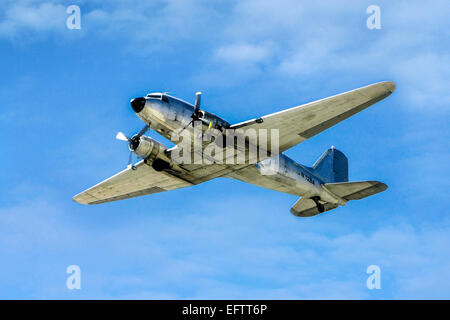 Douglas C-47A (DC3A) flying over Sarasota in Florida. Built in 1943 and now based at Punta Gorda FL - Stock Photo
