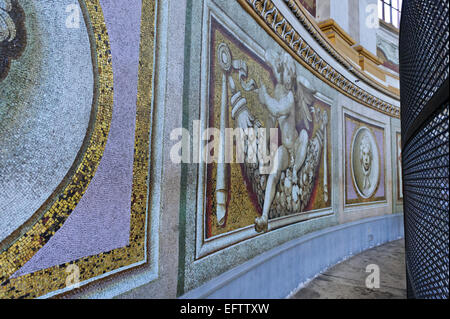 Mosaic paintings on the wall inside the dome of St Peter's Basilica, Vatican, Rome, Italy. - Stock Photo