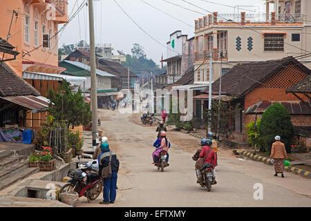 Motorcycles riding through the town Keng Tung / Kengtung, Shan State, Myanmar / Burma - Stock Photo