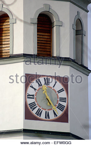 Clocks Clock on the top of a German Church in Munich area Bavaria Germany 11.30 Clock clocks big large face roman - Stock Photo